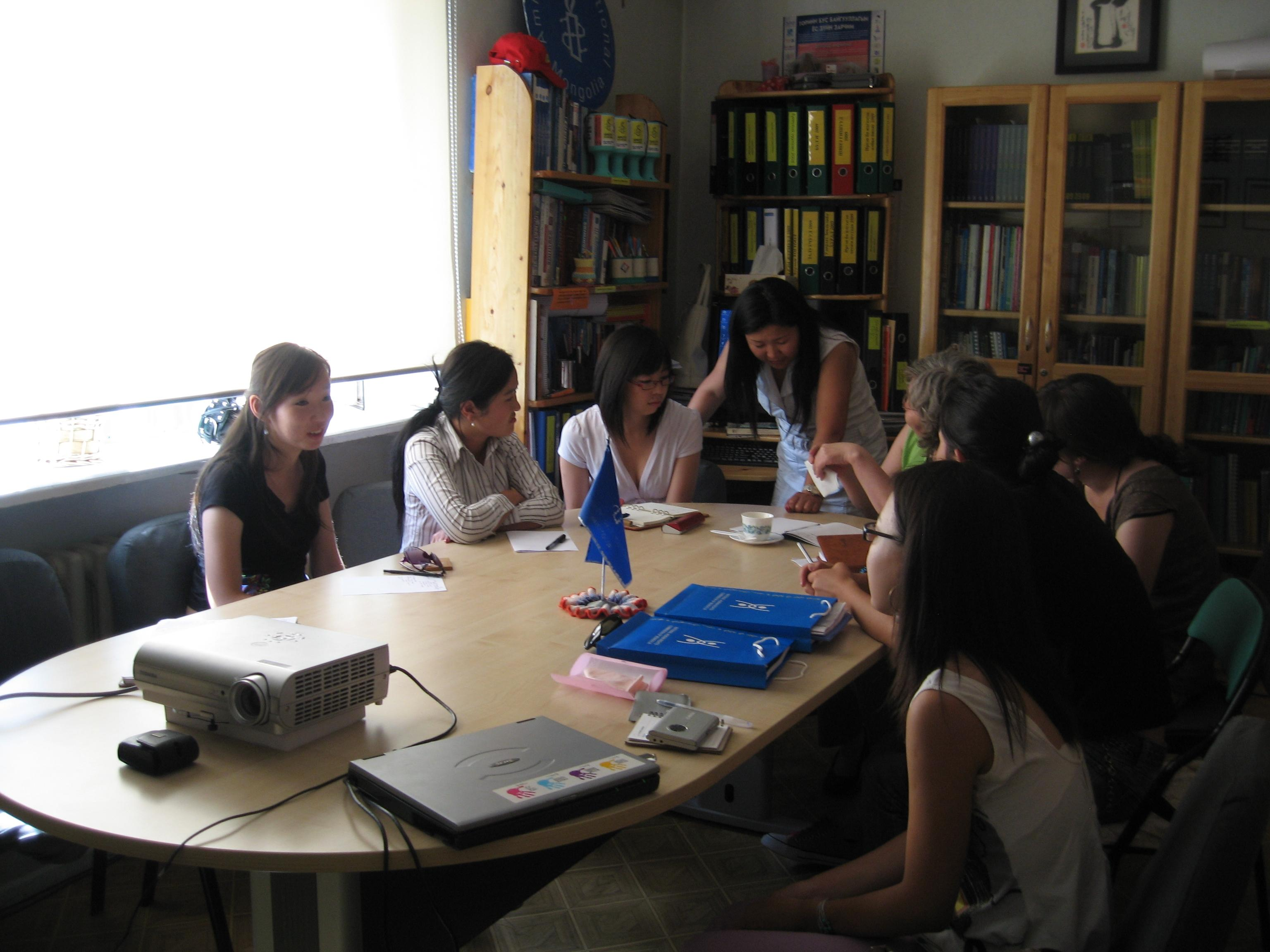 Students join staff in a meeting during their Law internships in Mongolia.